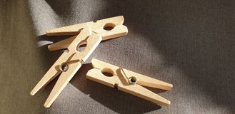 Clothes pegs made of wood. Wooden clothes pegs royalty free stock images