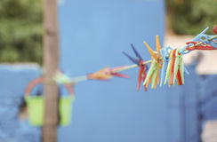 Clothes pegs on rope Stock Photo