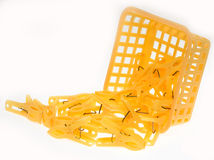 Clothes-pegs scatter from basket Stock Images