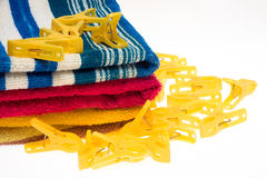 Clothes-pegs and towels Stock Photo