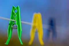 Clothes pegs on washing line Stock Images
