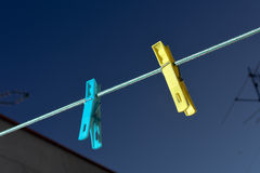 Clothes pegs. Washing line with two clothes pegs Royalty Free Stock Photo