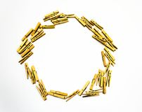 Clothes pegs. Wooden sprung clothes pegs arranged in a circle on a white background Stock Photography
