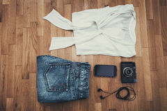 Clothes phone and camera Royalty Free Stock Photo
