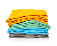 Clothes pile. Bright folded clothes stock photo