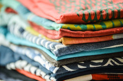 Clothes on a pile. Several shirts on a pile Royalty Free Stock Photos