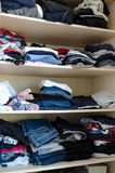 Clothes. In piles in a wardrobe Royalty Free Stock Photography