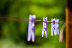 Clothes pin background. Clothes pins lined up on a wire Royalty Free Stock Photos