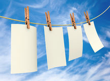 Clothes pin holding sheets Royalty Free Stock Images