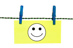 Clothes Pin Note. Note hanging from clothes pin with a smiley face on it Stock Photos