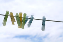 Clothes pins. In a row on line stock images