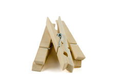 Clothes pins alpha. A set of three clothes pins isolated over white stock image