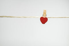 Clothes pins with small hearts Royalty Free Stock Photos