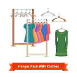 Clothes rack with dresses on hangers Stock Photos