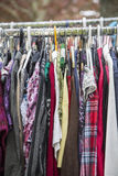 Clothes on a rack Stock Images