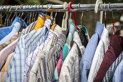 Clothes on a rack. On a flea market Royalty Free Stock Image