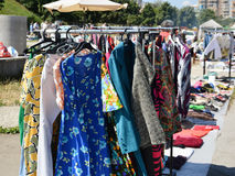 Clothes on a rack in a flea market. Stock Image