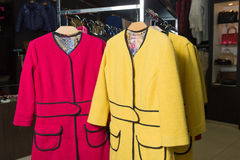Clothes rack with ladies coats for sale Royalty Free Stock Photography