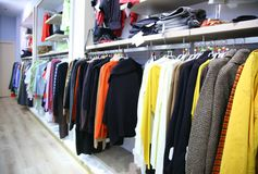 Clothes on rack in shop Stock Photography