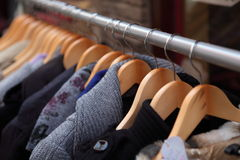 Clothes on racks Royalty Free Stock Photos