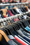 Clothes on racks Royalty Free Stock Photo