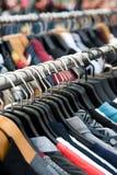 Clothes on racks Royalty Free Stock Photo