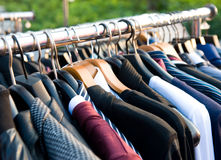 Clothes on racks Royalty Free Stock Images