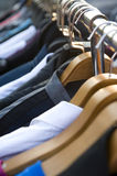 Clothes on racks Stock Photography