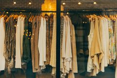 Clothes on racks Royalty Free Stock Image