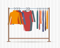 Clothes racks with dresses on hangers. Stock Photo
