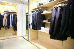 Clothes on racks in shop Royalty Free Stock Photos