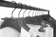 Clothes on racks in store Royalty Free Stock Photo
