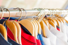 Clothes rail. Clothese rail full of clothes on hangers stock photos