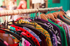 Clothes on a rail at street market Royalty Free Stock Photo