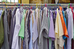 Clothes rails. Used shirts hanging at clothes rails Stock Photo
