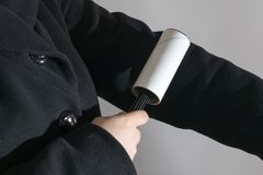 Clothes roller for cleaning of garbage and cat fur stock images