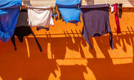 Clothes on rope dry after wash with shadow Royalty Free Stock Image