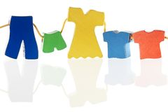 Clothes sale. Wood clothes on the string on the white background Royalty Free Stock Images