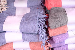 Clothes for sale. Beautiful color scarf roll closeup Stock Image