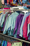Clothes sale at market. Clothes on sale at market or shop Royalty Free Stock Photo