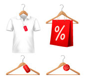 Clothes sale set with hangers and price tags. Royalty Free Stock Images