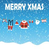 Clothes from Santa Claus. Hanging on a clothes line, blue colored snow fall background and text Merry Xmas vector illustration