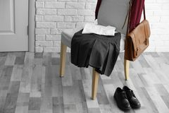 Clothes of schoolgirl on chair. Indoors Stock Photo
