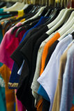 Clothes (selective focus). Female clothes in a fashion shop Royalty Free Stock Photo