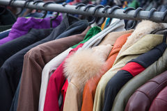 Clothes. Selective focus some used leather clothes hanging on a rack in market royalty free stock photos