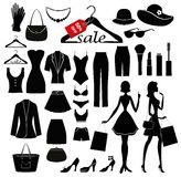 Clothes set and women with the shopping bags. Stock Photos