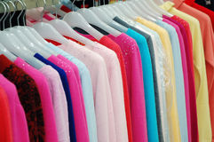 Clothes on shelf. Colorful fashionable clothes on shelf Royalty Free Stock Photos