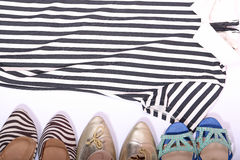 Clothes and shoes watches with white background Royalty Free Stock Image