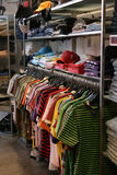 Clothes in shop. Clothes in new modern store Stock Images