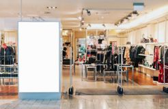 Clothes shop entrance with empty billboard mockup. To place text, logo or advertisement stock image